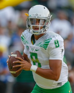 EUGENE, OR - AUGUST 30: Quarterback Marcus Mariota #8 of the Oregon Ducks warms up prior to the game against the South Dakota Coyotes at Autzen Stadium on August 30, 2014 in Eugene, Oregon. (Photo by Otto Greule Jr/Getty Images)