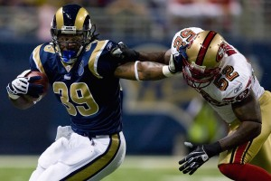 ST. LOUIS, MO - DECEMBER 21: Steven Jackson #39 of the St. Louis Rams looks to get past Patrick Willis #52 of the San Francisco 49ers at the Edward Jones Dome on December 21, 2008 in St. Louis, Missouri.  (Photo by Dilip Vishwanat/Getty Images)